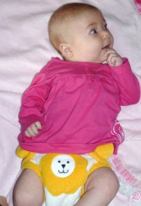 Cute baby wearing a lion Starbunz pocket diaper