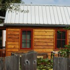 tiny house, side view, wood with metal roof
