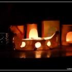 Six different lanterns, each lit with a candle from the inside, on a black night background