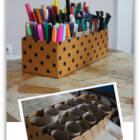 Marker/Texta caddy made out of a covered shoe box with toilet rolls jam inside.